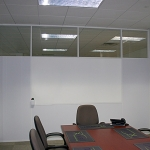 Conference room with white extrusions and integrated whiteboard