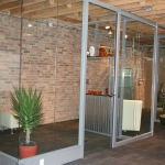 Chicago showroom with wing back wall and glass doors