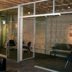 Glass pocket door - NxtWall glass office wall systems