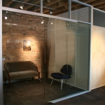 Pocket door glass office with stainless flush pull door hardware