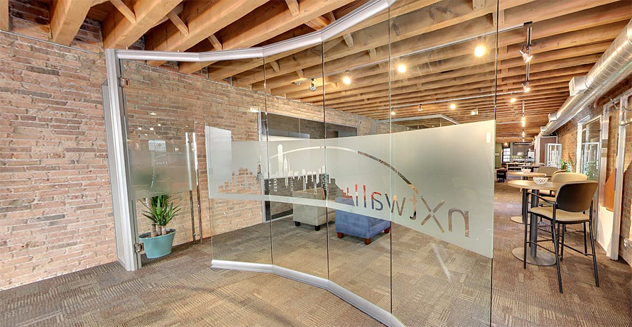 Curved glass conference room wall with 3M window film