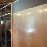 Veneer wall panels with matching veneer-wrapped wall trim