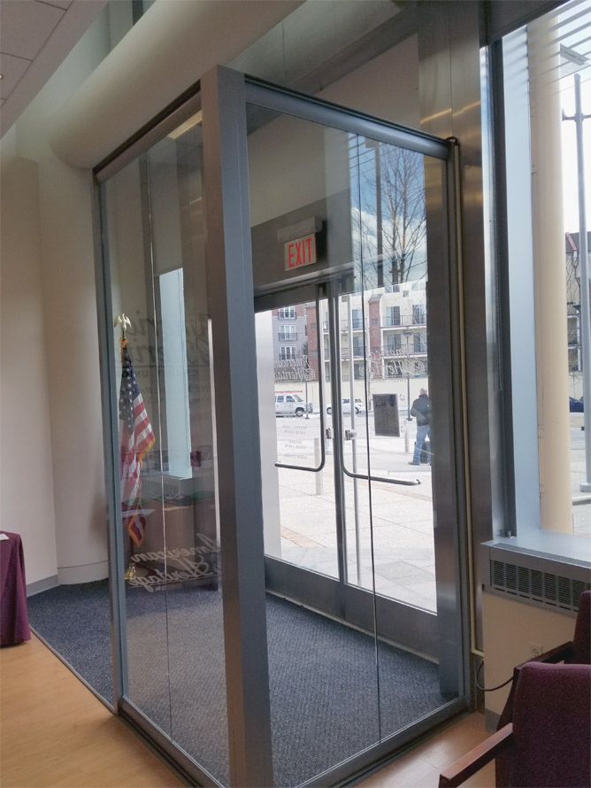 Freestanding glass vestibule with View Series - Credit Union glass wall installation