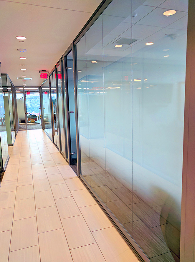 Glass office walls with applied decorative window film
