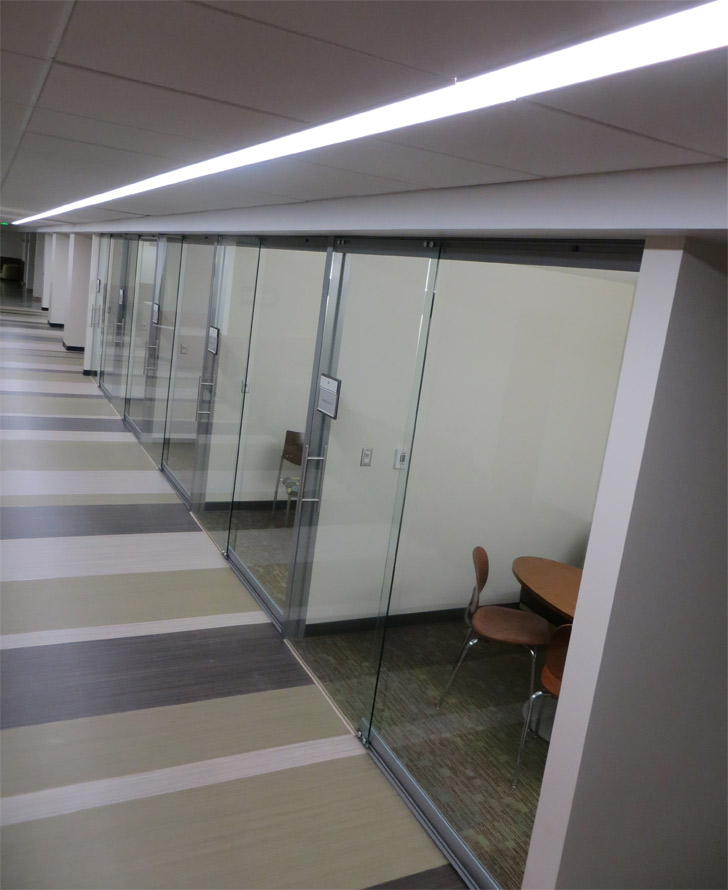 Glass office fronts with sliding glass doors