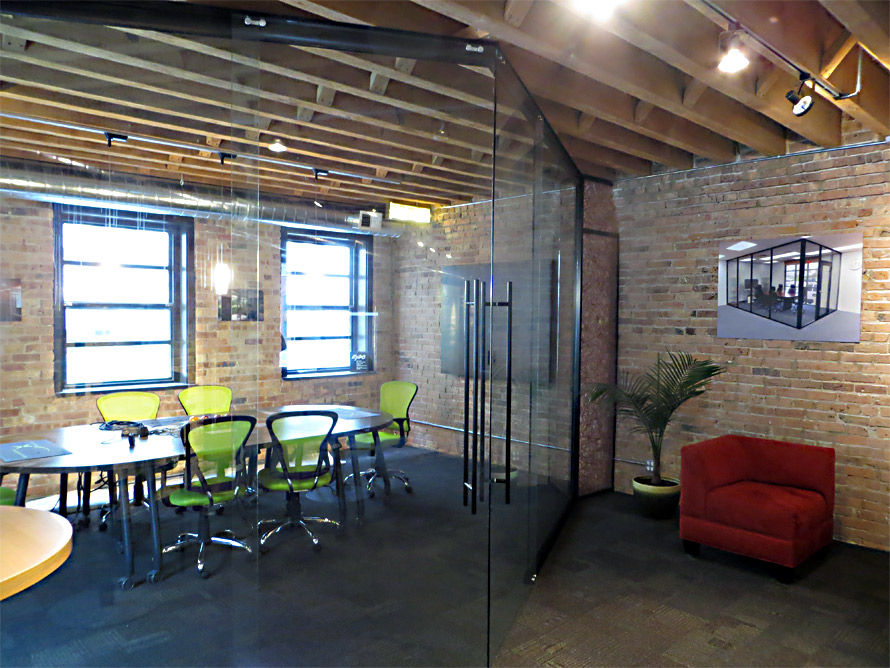 nxtwall chicago showroom double sliding glass door angled entrance conference room