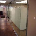 Architectural glass office front with glass open corner