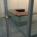Bank glass wall installation with locking barpull sliding doors