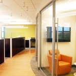 Curved glass office fronts with frameless glass swing door