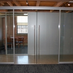 Double frameless glass sliding doors - conference room