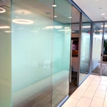 Elegant full height glass fronts with designer glass film applied
