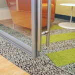 Frameless glass swing door with barpull hardware - detail