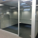 Glass office with frameless glass door