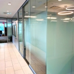 Glass offices with decorative window film and open corner