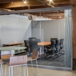 Glass conference room with 3form ecoresin decorative wall panel