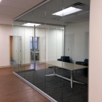 Glass conference room with modern open glass corner