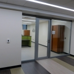 Glass office fronts - butt jointed glass solution with aluminum framed door