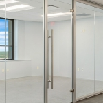 Modern glass walls with frameless swing glass door
