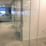 Floor-to-ceiling glass offices with sliding glass doors