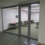Center mounted seamless glass office (Higher Education)