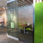 Curved Glass Open Office with SYNZoysia Platinum 300 wall panel