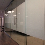 Double sliding glass door conference room with privacy film
