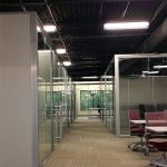 Freestanding View series glass office fronts with sliding doors