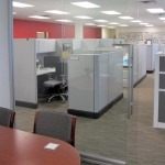 Full glass conference front with sliding door