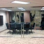 Glass conference room with double swing glass hinged doors
