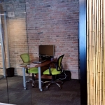 Glass fishbowl office View series with bamboo reeds wall panel