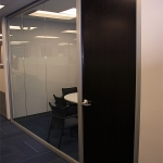 Glass meeting room with solid wood veneer door