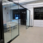 Glass office front with double glass sliding doors