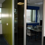 Glass office front with open corner