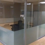 Glass office with frameless glass sliding door