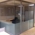 Glass office with frosted privacy film and sliding glass door