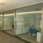 Glass offices with sliding glass doors