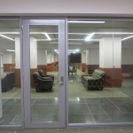 Reversible aluminum framed glass office door