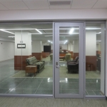 Seamless glass front with aluminum frame glass door