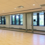 Glass seamless multi-purpose room with hardwood flooring View series interior walls