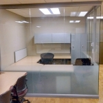 Seamless glass office with privacy film at bottom of glass panels