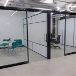 View office fronts with glass sliding doors and black extrusions