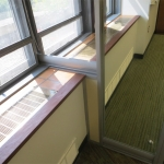 View series center mounted glass wall and window sill integration