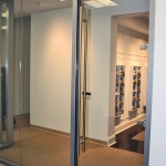 View series glass front with full-height frameless swing door