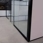 Freestanding View series glass office fronts with flex sidewalls