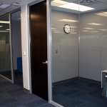 View series glass walls with dark veneer doors