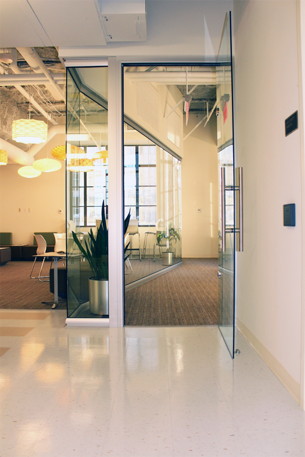 View full-height glass offices and frameless glass door