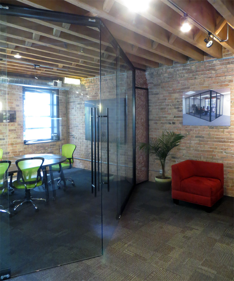 Angled Entrance Glass Double Sliding Doors with Black Track and Wall Trim