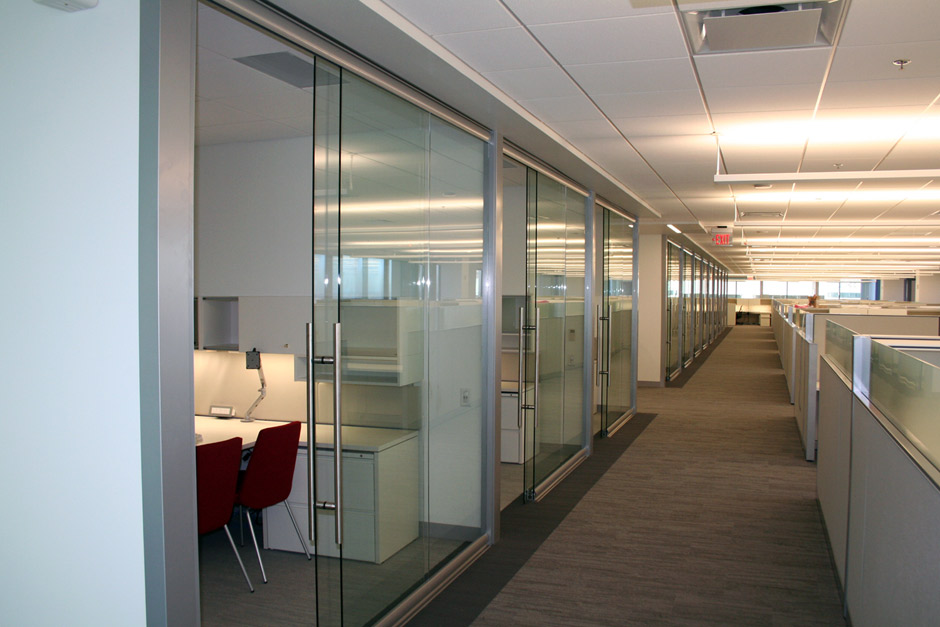 Use of demountable glass walls in small office Opening glass walls