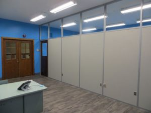 retrofitting classrooms in higher education with clerestory demountable walls and old school doors.