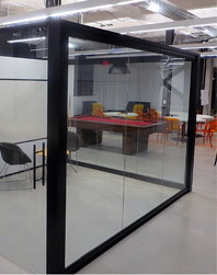 Glass wall panel office with collaborative space